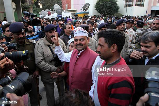 Aam Aadmi Party winning Candidate from Adarsh Nagar Assembly constituency Pawan Sharma arrives for a meeting in Delhi . Results from Delhi are a...