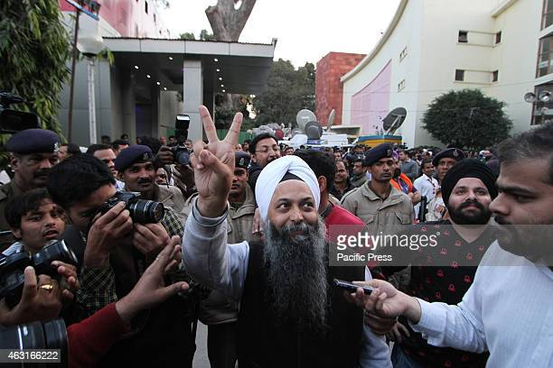 Aam Aadmi Party winning Candidate from Rajouri Garden Assembly constituency Jarnail Singh arrives for a meeting in Delhi . Results from Delhi are a...
