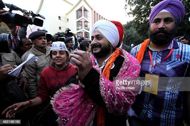 Aam Aadmi Party winning Candidate from Tilak Nagar Assembly constituency Jarnail Singh arrives for a meeting in Delhi . Results from Delhi are a...