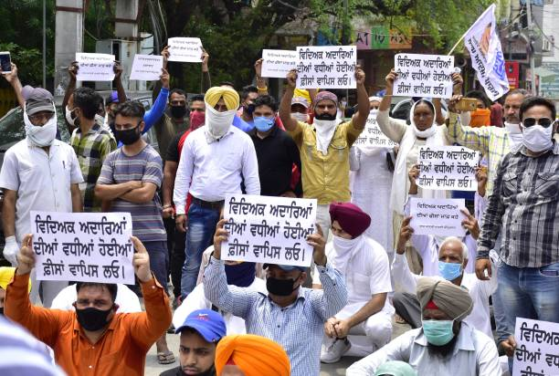 IND: Aam Aadmi Party Workers Protest Against Fee Hike For Medical Students Amid The Lockdown In Amritsar