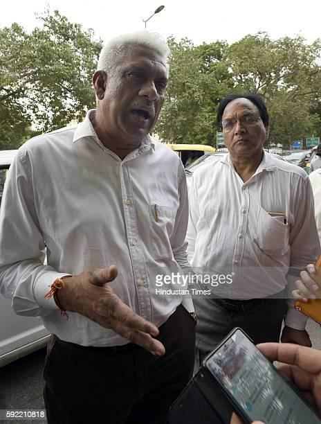 Aam Adami Party Delhi MLAs Madan Lal and Anil Bajpai leave after attending the hearing at Election Commission of India over office of profit row at...