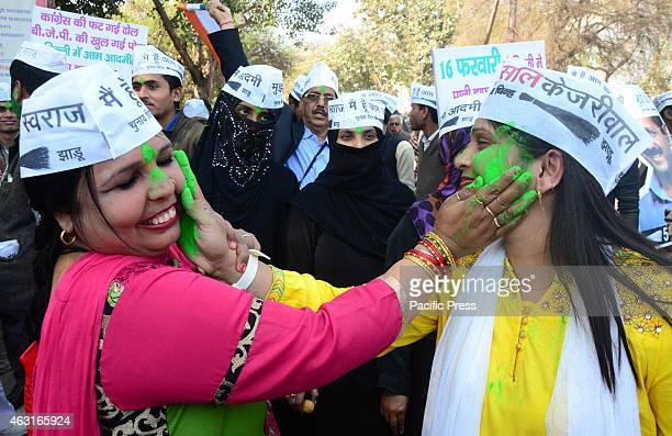 Aam Adami Party supporters and workers celebrate their party victory in Delhi Assembly Election