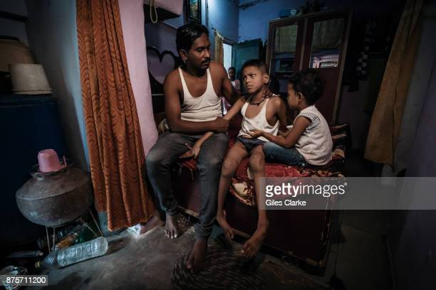 Aaman 15 years old with his father Rafeeq at home in the Aishbag neighborhood Aaman was born to parents contaminated by a carcinogenic and mutagenic...