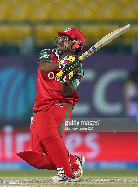 Aamer Ali of Oman hits the ball towards the boundary during the ICC Twenty20 World Cup match between Ireland and Oman at the HPCA Stadium on March 9...