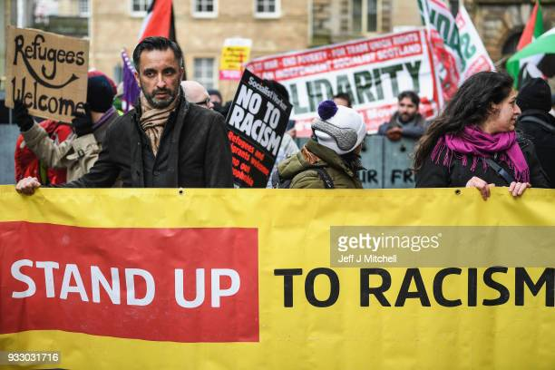 Aamer Anwar a prominent Scottish lawyer joins an Antiracism rally through the city centre on March 17 2018 in Glasgow Scotland The event organised by...
