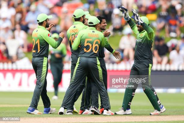 Aamer Yamin of Pakistan celebrates with Sarfraz Ahmed of Pakistan after taking the wicket of during game five of the One Day International Series...
