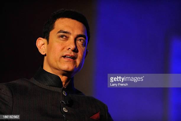 Aamir Kahn speaks at the 2013 America Abroad Media Awards Dinner at Andrew W Mellon Auditorium on October 28 2013 in Washington DC