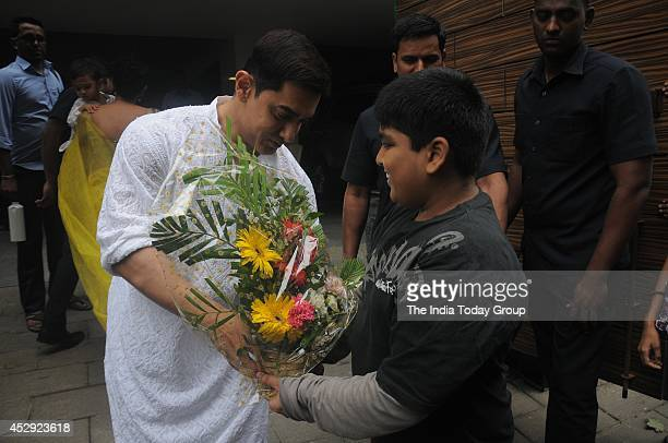 Aamir Khan along with fan outside his residence in Mumbai greeting his fans on the occasion of Eid