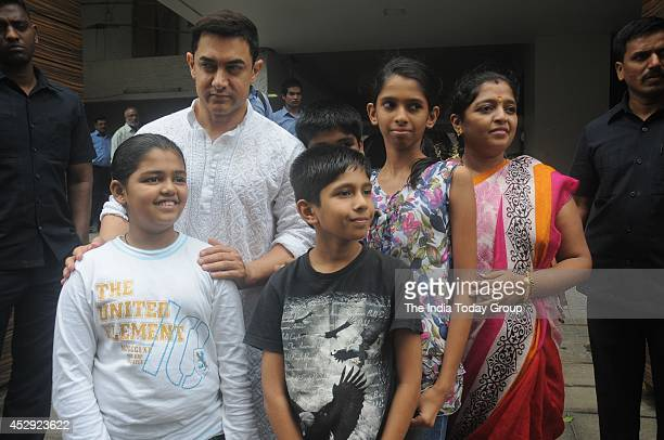 Aamir Khan along with fans outside his residence in Mumbai greeting his fans on the occasion of Eid