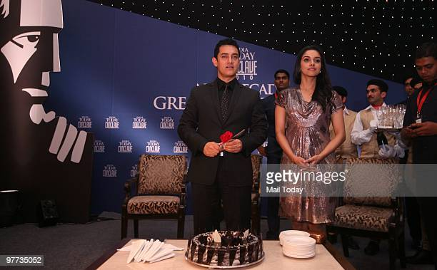 Aamir Khan and Asin Thottukmal get ready to cut Aamir's birthday cake at the dinner party hosted after the India Today Conclave ended in New Delhi on...
