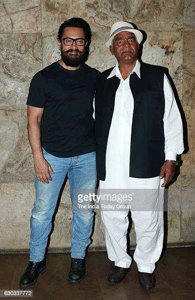Aamir Khan and Mahavir Singh Phogat during the special screening of film Dangal in Mumbai