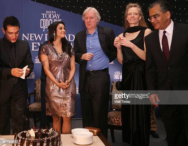 Aamir Khan Asin and James Cameroon with his wife Suzy Amis and Aroon Purie get ready to cut Aamir's birthday cake at the dinner party hosted after...