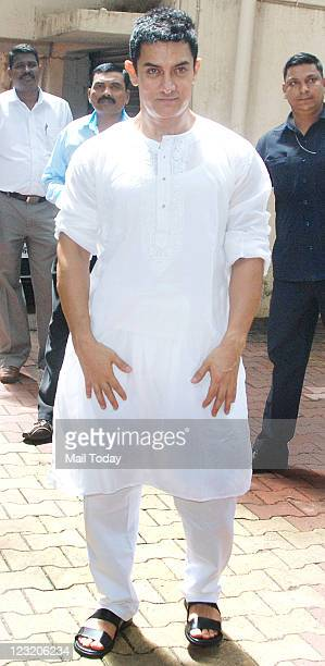Aamir Khan is pictured by media as he wishes Eid to his fans at his house in Mumbai on August 31 2011