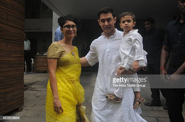 Aamir Khanalong with wife Kiran Rao and son Azadgave a happy family pose outside their residence in Mumbai as he greeted his fans on the occasion of...