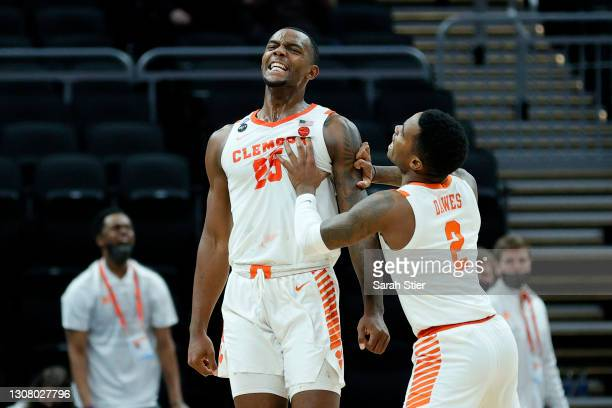Aamir Simms and Al-Amir Dawes of the Clemson Tigers react after a play in the second half against the Rutgers Scarlet Knights in the first round game...