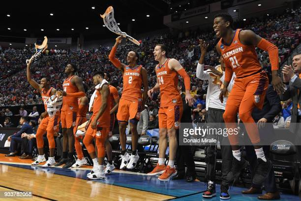 Aamir Simms Elijah Thomas Shelton Mitchell Marcquise Reed David Skara and Anthony Oliver II of the Clemson Tigers celebrate on the bench as they...