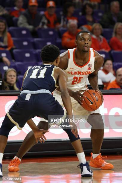 Aamir Simms forward of Clemson looks to pass the ball during a college basketball game between the Charleston Southern Buccaneers and the Clemson...