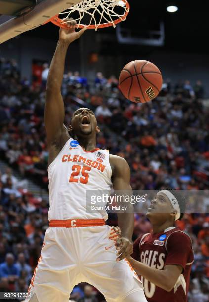 Aamir Simms of the Clemson Tigers dunks against Jemerrio Jones of the New Mexico State Aggies in the first half in the first round of the 2018 NCAA...