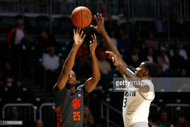 Aamir Simms of the Clemson Tigers shoots over Anthony Lawrence II of the Miami Hurricanes during the first half at the Watsco Center on February 13...
