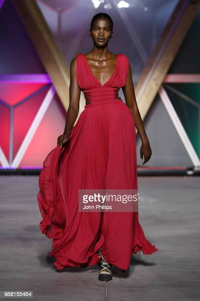 Aamito Lagum walks the Runway at Fashion for Relief Cannes 2018 during the 71st annual Cannes Film Festival at Aeroport Cannes Mandelieu on May 13...