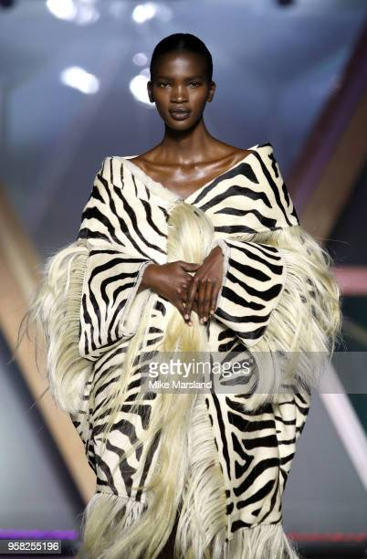 Aamito Lagum walks the runway during Fashion For Relief Cannes 2018 during the 71st annual Cannes Film Festival at Aeroport Cannes Mandelieu on May...