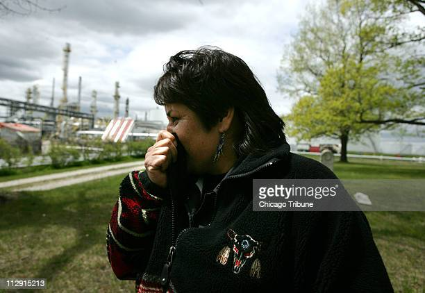 Aamjiwnaang activist Ada Lockridge holds her nose as intense odors pass through the native burial grounds on the reserve across from Suncorp Energy...