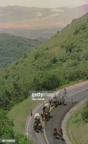 AAmormondescent0721AG–– The Mormon Trail wagon train winds its way through the steep mountains of the Wasatch National Forest on a day that was the...
