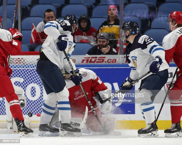 Aapeli Rasanen of Finland scores on Kasper Krog of Denmark in the first period during the IIHF World Junior Championship at KeyBank Center on...
