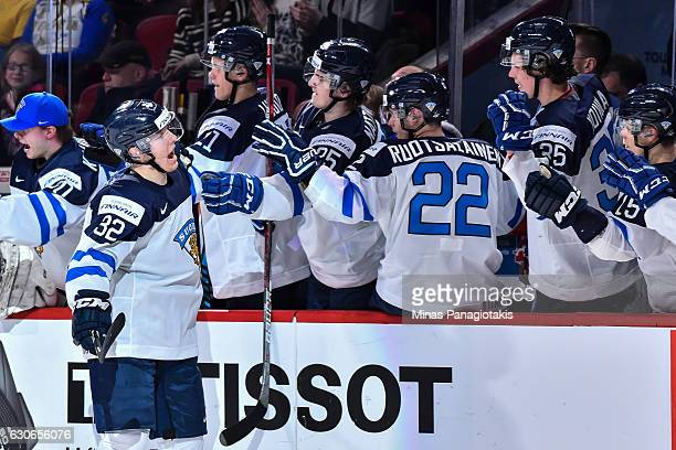Aapeli Rasanen of Team Finland celebrates a first period goal with teammates on the bench during the 2017 IIHF World Junior Championship preliminary...