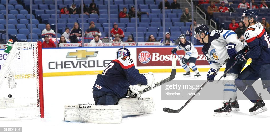 Aapeli Räsänen #22 of Finland tipped a shot past Roman Durny #30 of Slovakia to give Finland a 2-1 lead during the second period of play in the IIHF World Junior Championships at the KeyBank Center on December 30, 2017 in Buffalo, New York.