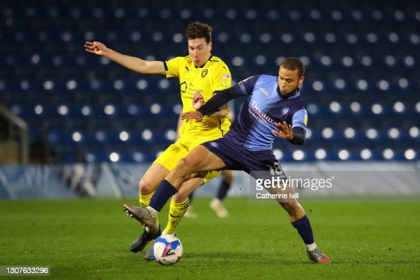 Aapo Halme of Barnsley FC and Curtis Thompson of Wycombe Wanderers battle for the ball during the Sky Bet Championship match between Wycombe...