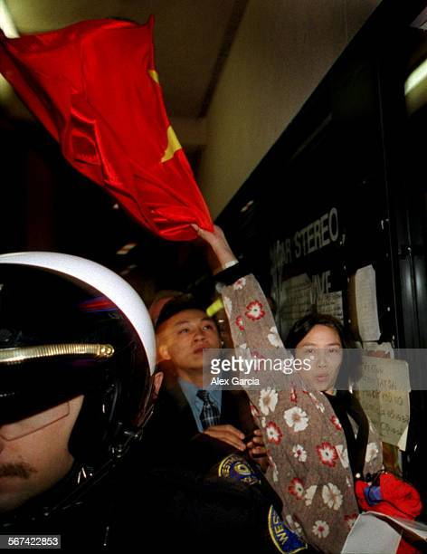 AAprotestoverhead0121AAG––To an angry crowd of Vietnamese–American protestors and a police escort the wife of Hitek TV and VCR storeowner Truong Van...