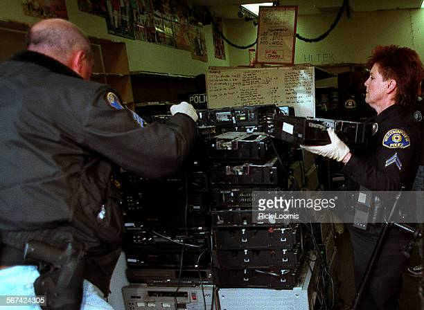 AARaidVCR0305RL––Sgt Dwight Moore left and Detective Adelle Wagner right of the Westminster Police Department confiscate approximately 130 VCRs from...