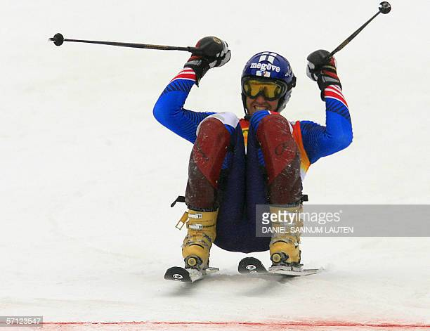 French Stephane Tissot celebrates as he crosses the finish line of the Alpine Ski World Cup finals 18 March 2006 in Aare northern Sweden Tissot...