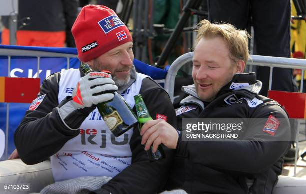 Norwegians Lasse Kjus and Kjetil Andre Aamodt drink Champagne and beer to celebrate Kjus retirement from ski competition after the SuperG at the...
