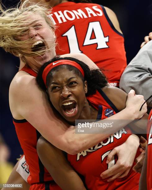 Aari McDonald and Cate Reese of the Arizona Wildcats celebrate with teammates after defeating the UConn Huskies during the fourth quarter in the...