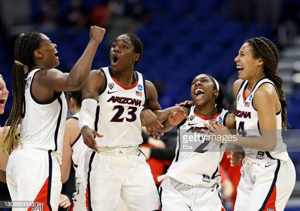 Aari McDonald of the Arizona Wildcats and her teammates Trinity Baptiste, Bendu Yeaney and Sam Thomas celebrate the win over the Indiana Hoosiers...