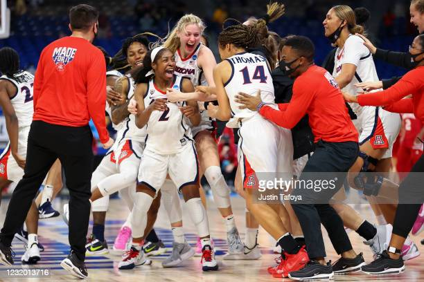 Aari McDonald of the Arizona Wildcats celebrates with her teammates after defeating the Indiana Hoosiers in the Elite Eight round of the NCAA Womens...