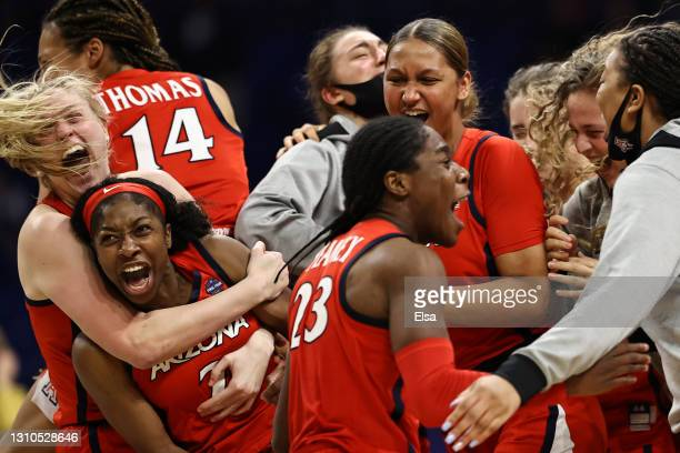 Aari McDonald of the Arizona Wildcats celebrates with teammates after defeating the UConn Huskies during the fourth quarter in the Final Four...