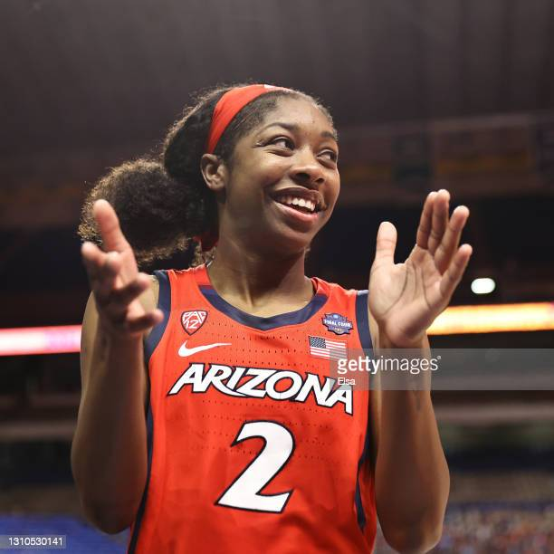 Aari McDonald of the Arizona Wildcats celebrates with teammates after defeating the UConn Huskies in the Final Four semifinal game of the 2021 NCAA...