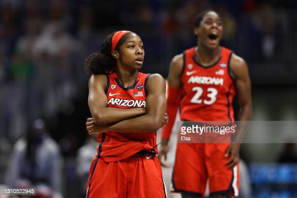 Aari McDonald of the Arizona Wildcats celebrates with teammates against the UConn Huskies during the second quarter in the Final Four semifinal game...