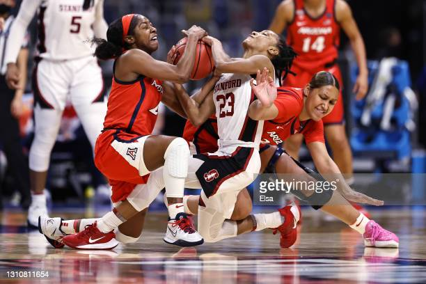 Aari McDonald of the Arizona Wildcats steals the ball from Kiana Williams of the Stanford Cardinal in the National Championship game of the 2021 NCAA...