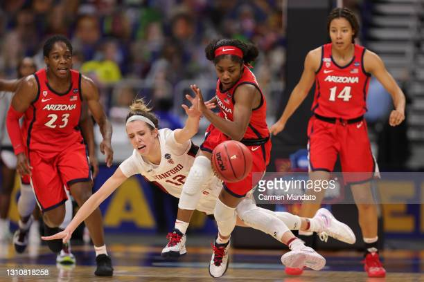 Aari McDonald of the Arizona Wildcats steals the ball from Lexie Hull of the Stanford Cardinals in the National Championship game of the 2021 NCAA...