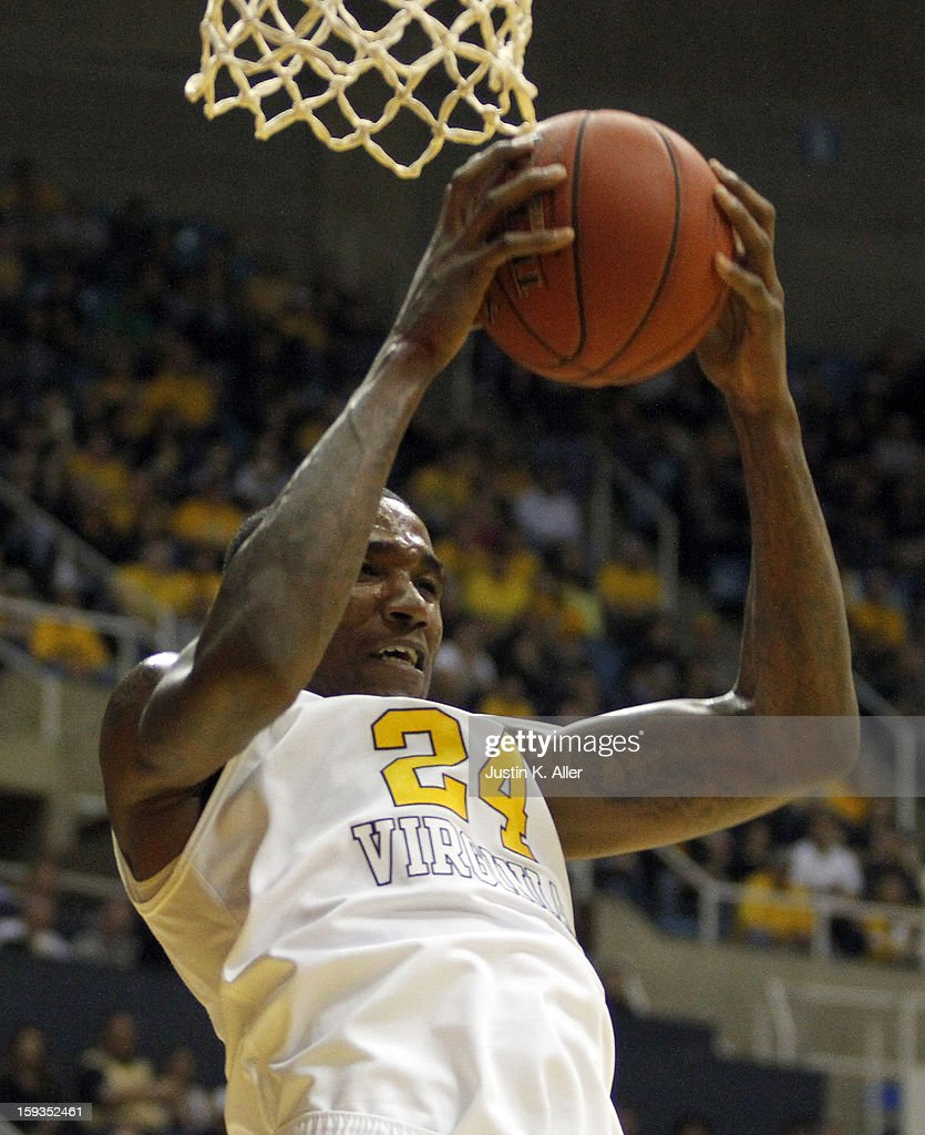 Aaric Murray #24 of the West Virginia Mountaineers rebounds the ball against against the Kansas State Wildcats during the game at at the WVU Coliseum on January 12, 2013 in Morgantown, West Virginia.