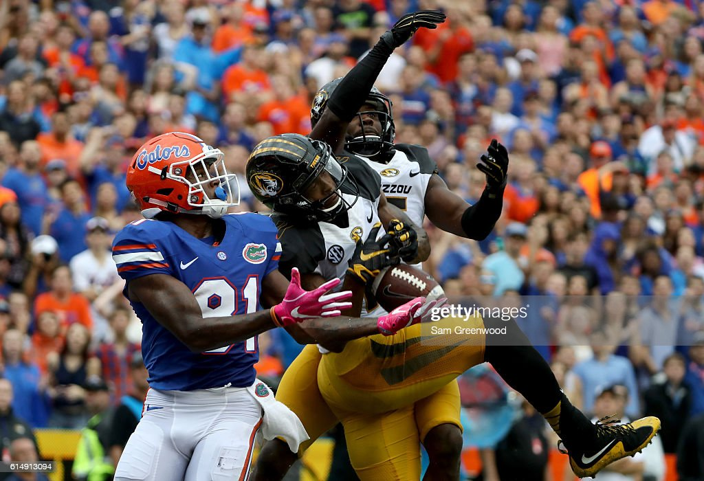 Aarion Penton #11 of the Missouri Tigers attempts to breakup a pass intended for Antonio Callaway #81 of the Florida Gators during the game at Ben Hill Griffin Stadium on October 15, 2016 in Gainesville, Florida.