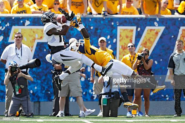 Aarion Penton of the Missouri Tigers makes an interception against the West Virginia Mountaineers in the second half of the game at Milan Puskar...