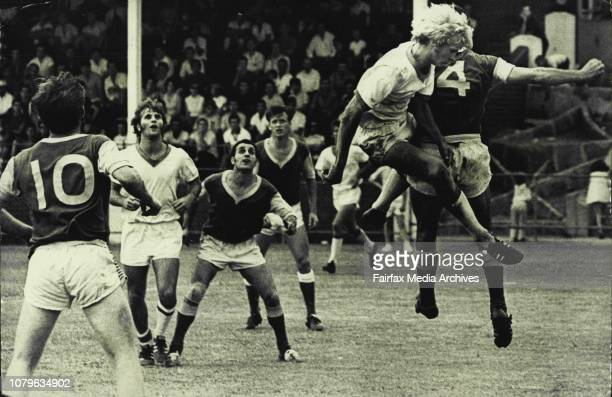 There's plenty of action in the Canterbury goalmouth as SydneyPrague put on the pressure Climbing high is Prague centreforward Bill Reilly who helped...