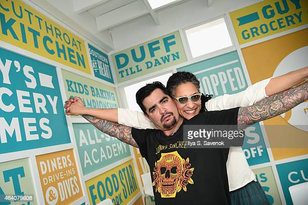 Aarón Sánchez and carla Hall pose at the KitchenAid Culinary Demonstrations during the 2015 Food Network Cooking Channel South Beach Wine Food...