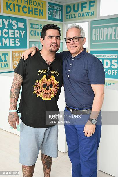 Aarón Sánchez and Geoffrey Zakarian pose at the KitchenAid Culinary Demonstrations during the 2015 Food Network Cooking Channel South Beach Wine Food...