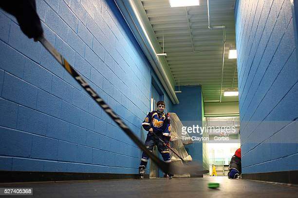 Aaron Aboodi practices outside the dressing room with team mate CK Giancola before the Mid Fairfield Yankees Pee Wee Major Ice Hockey teams match...